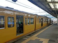 JNR 115 Setouchi yellow livery Sanyo Main Line local at Shin-Yamaguchi Station.jpg
