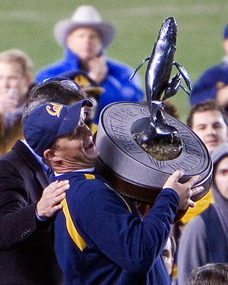 Jeff Tedford - Tedford accepts the 2006 Holiday Bowl trophy