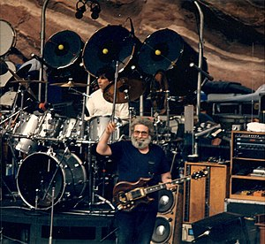 Grateful Dead - Grateful Dead performing at Red Rocks Amphitheatre in 1987: Jerry Garcia (custom '''Tiger''' guitar), Mickey Hart (drums).
