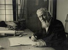 Plečnik seated at a drawing table