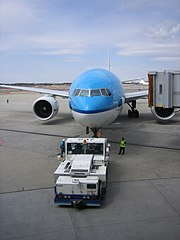 An aircraft tow tractor moving a KLM boeing 777