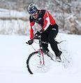 Kai Reus at his bike in the snow.jpg