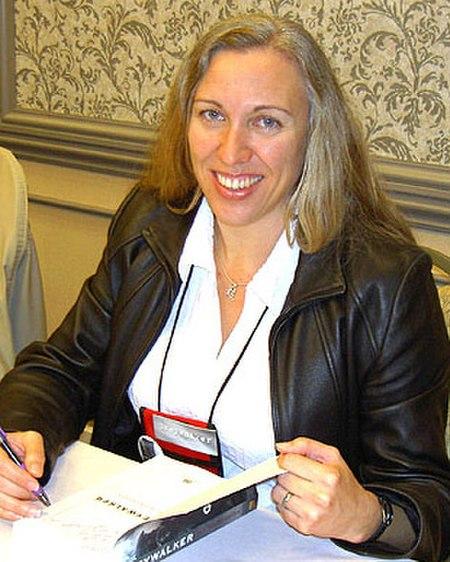 Kat Richardson signing advanced copies of first book at 2006 Bouchercon.jpg