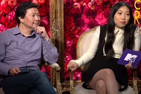 Ken Jeong and Awkwafina hold purple MTV cards
