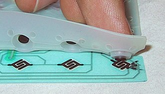 Keyboard technology - How a dome-switch keyboard works: Finger depresses the dome to complete the circuit