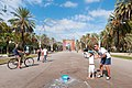 Kid an bubbles in front of the Arc de Triomf.jpg