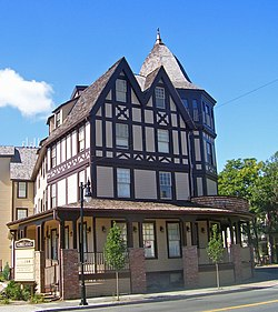 A Brown And Cream Colored Building With Peaked Pointy Roofs