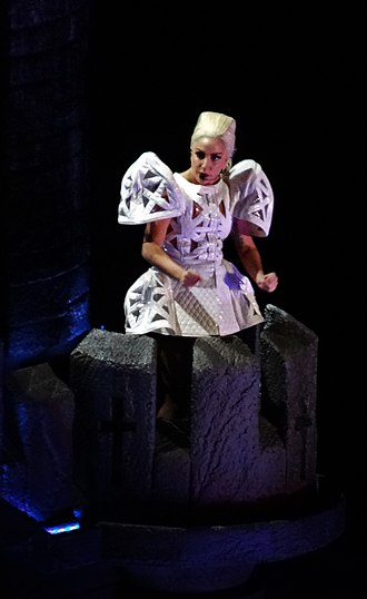 "Judas (Lady Gaga song) - Lady Gaga performing ""Judas"" on The Born This Way Ball, standing on top of the medieval castle prop."