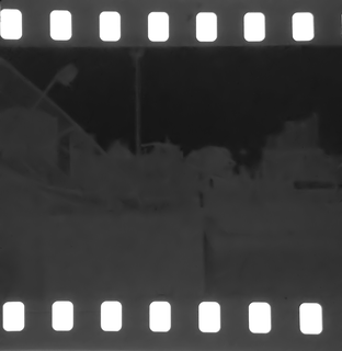 An invisible image produced by the exposure of a photosensitive material to light.
