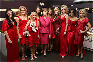 "Kristin Chenoweth - Chenoweth (holding her dog, Madeline Kahn ""Maddie"" Chenoweth) with Laura Bush and celebrity models in the 2007 Red Dress Collection Celebrity Fashion Show to raise awareness of heart disease"