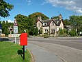 Level Crossing, Post box and B and B at Brodie - geograph.org.uk - 253579.jpg