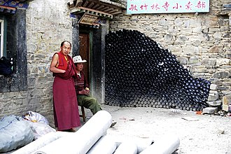 Beer in Tibet - A large stack of beer bottles at Mindroling Monastery, a stark contrast between traditional beliefs and growing outside influences