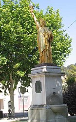 A replica of the Statue of Liberty in the town square