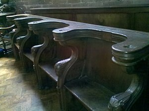 John Mirk - Pews at St Peter's Collegiate Church in Wolverhampton. These were originally Lilleshall Abbey choir stalls, where the canons sat during worship, and were donated to the church after the Dissolution of the monasteries.