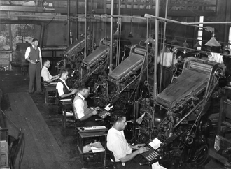 Hot metal typesetting - Row of Linotype operators at the Chicago Defender newspaper, 1941