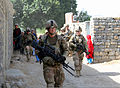 Local children watch as U.S. Soldiers with Echo Company, 2nd Battalion, 506th Infantry Regiment, 4th Brigade Combat Team, 101st Airborne Division, make their way through a village during a mission in Khowst 130602-A-DQ133-214.jpg