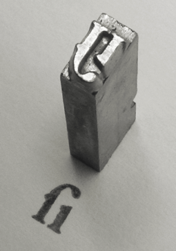 A piece of cast metal type, Garamond style long s i ligature. See also: Sort. Long S-I Garamond sort 001.png