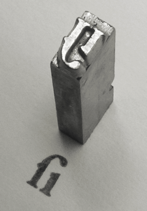 History of Western typography - A piece of cast metal type, Garamond style long s / i ligature. See also: movable type.