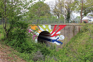 "West Midtown - The Lucile Avenue Bridge on the Westside Beltline trail displays a piece of street art entitled ""The Highball Artist"" painted by Hadley Breckenridge, a local Atlanta artist."