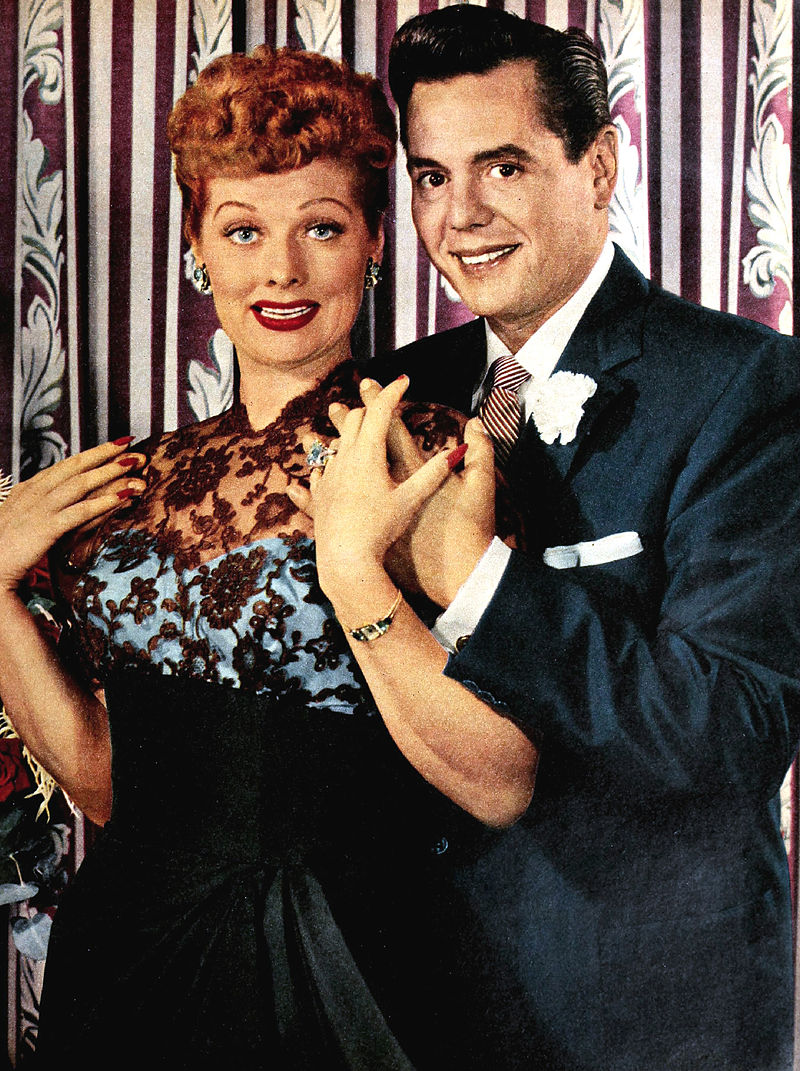 Colored glamorous shot of Lucille Ball and Arnaz standing.