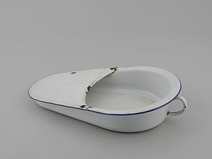 Activities of daily living assistance - A fracture bedpan used for those with hip fractures.