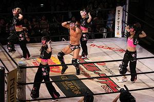 Magnum Tokyo - Magnum TOKYO (center) and dancers during his ring entrance.