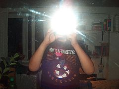 Man photographing himself in a mirror with flash.jpg