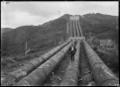 Mangahao Power Station, exterior view of penstocks, 1924 ATLIB 301149.png