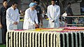 Manmohan Singh paying floral tributes at the Samadhi of Mahatma Gandhi on his 143rd birth anniversary, at Rajghat, in Delhi on October 02, 2012. The Union Minister for Urban Development, Shri Kamal Nath is also seen.jpg