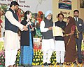 Manmohan Singh presenting award for the best performing Gram Panchayat for the year 2009-10 at the Mahatma Gandhi NREGA Sammelan-2011, on the completion of five years of Mahatma Gandhi NREGA, in New Delhi (1).jpg