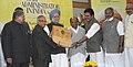 Manmohan Singh presenting the K. Karunakaran Foundation Best Administrator of India Award- 2011 to the Union Finance Minister, Shri Pranab Mukherjee, at a function, in New Delhi. The Defence Minister, Shri A. K. Antony.jpg