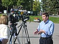 Mark Begich in television interview, 2008 Labor Day picnic.jpg