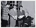 Mayor John F. Collins shaking hands with a young man at the Men of the Future dinner (13560872173).jpg