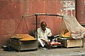 Merchant selling namkeen snacks, Khan Market, Delhi.jpg