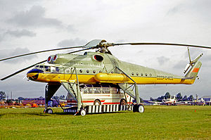 Mil Mi-10 - Mil Mi-10 displayed at the 1965 Paris Air Show with a LAZ bus carried beneath it.