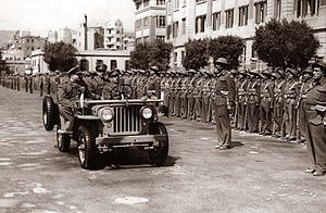 King Farouk I of Egypt inspecting small army u...
