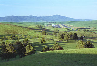Pullman–Moscow Regional Airport - Pullman–Moscow Regional Airport from the southwest in June 2000, runway 6, aligned with Moscow Mountain in Idaho