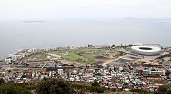 Mouille Point along the coastline with Green Point in the foreground. Robben Island in the distance, left
