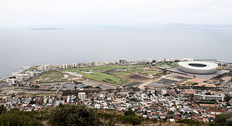 Mouille Point - Mouille Point along the coastline with Green Point in the foreground. Robben Island in the distance, left