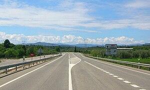 N-232 road (Spain) - N-232 road near La Jana with the Serra de Vallivana and Serra del Turmell in the background.