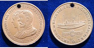 RMS Ophir - 1901 Commemorative medallion for New Zealand school children. The obverse shows Duke and Duchess of Cornwall and York, who visited New Zealand on their tour of the British Empire. The reverse shows HMS Ophir, on which the Royal couple made their tour.
