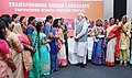 "Narendra Modi interacting with the beneficiaries of Pradhan Mantri Awas Yojana (Urban), during the event ""Transforming Urban Landscape Third Anniversary of Pradhan Mantri Awas Yojana (Urban).JPG"