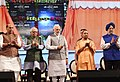 "Narendra Modi laying the foundation stone for various projects under Flagship Mission, during the event ""Transforming Urban Landscape Third Anniversary of Pradhan Mantri Awas Yojana (Urban).JPG"