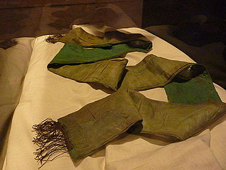Ned Kelly - At age 11, Kelly saved a young boy from drowning in a creek and was awarded this green sash in recognition of his bravery. Kelly wore the sash under his armour during his last stand at Glenrowan. It is still stained with his blood (Benalla Museum).
