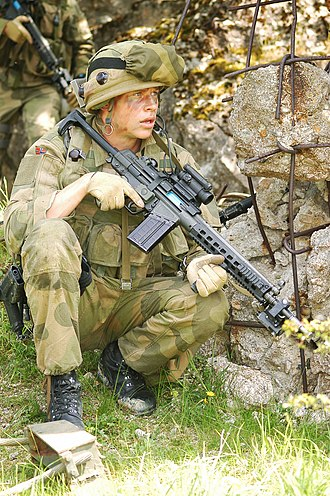 Heckler & Koch G3 - A Norwegian soldier with the license-built AG-3F2 model fitted with a Brügger & Thomet railed forend, vertical grip and Aimpoint red dot sight.