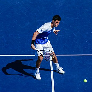 Novak Đoković (Djokovic) hits a volley during ...
