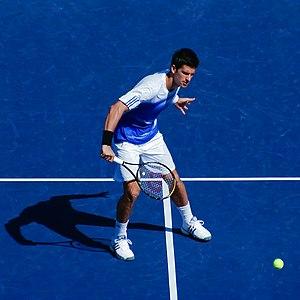 Novak Đoković (Djokovic) hits a volley during ...