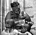 Oiling the Braids, Omerate, Ethiopia (15100744137).jpg