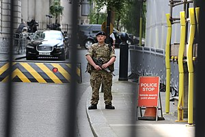 UK Threat Levels - British military personnel guarding Downing Street as part of Operation Temperer following the 2017 Manchester Arena bombing.