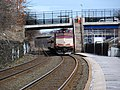 Outbound train arriving at Newtonville, March 2013.JPG